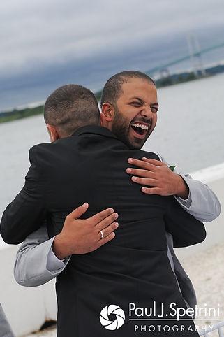 Nader receives a congratulatory hug prior to his July 2017 wedding ceremony at Belle Mer in Newport, Rhode Island.