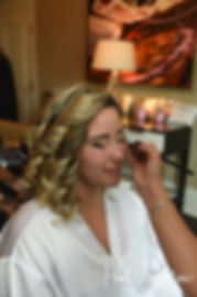 Sarah has her makeup done during her bridal prep session at The Omni Hotel in Providence, Rhode Island prior to her October 2018 wedding.
