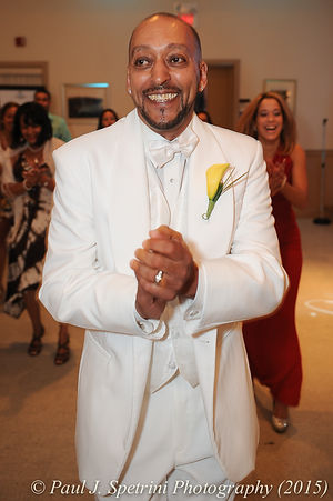 Joe Andrade dances during his wedding.