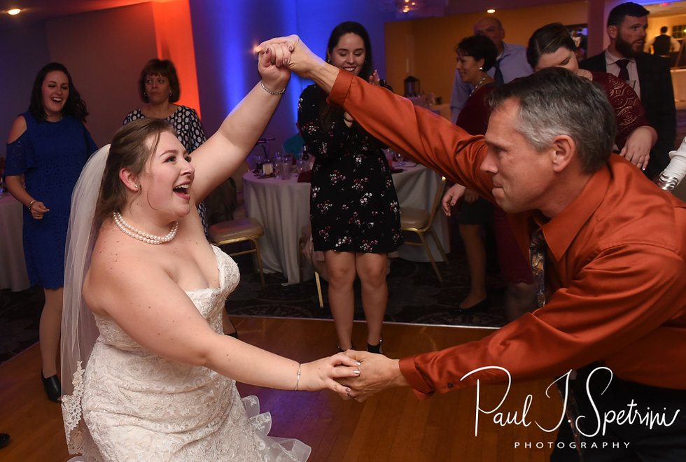 Stephanni dances with a guest during her October 2018 wedding reception at Rachel's Lakeside in Dartmouth, Massachusetts.