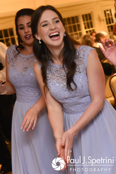 Guests laugh during Melissa and Jordan's May 2017 wedding reception at Independence Harbor in Assonet, Massachusetts.