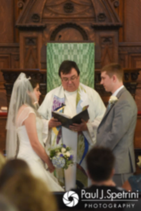 Gianna and Neil listen to their officiant during their July 2017 wedding ceremony at Peace Dale Congregational Church in South Kingstown, Rhode Island.