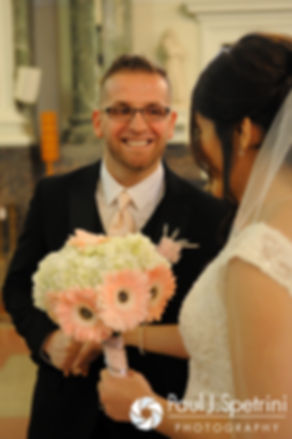 Sebastian smiles at Maria during their March 2016 Rhode Island wedding at the Church of St. John the Baptist in Pawtucket, Rhode Island.