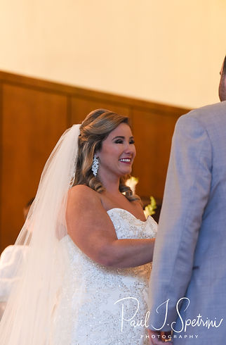 Sarah looks at Anthony during her October 2018 wedding ceremony at St. Augustine Catholic Church in Providence, Rhode island.