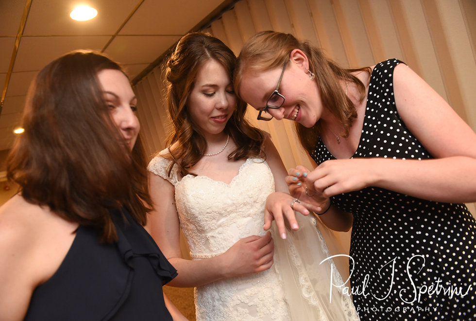 Sarah shows off her ring to friends during her June 2018 wedding reception at Pleasant Valley Country Club in Sutton, Massachusetts.