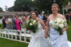 Laura and Marijke walk down the aisle together following their June 2018 wedding ceremony at Independence Harbor in Assonet, Massachusetts.