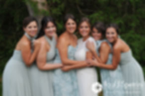Jennifer poses for a photo with her bridesmaids prior to her August 2017 wedding ceremony at The Inn at Mystic in Mystic, Connecticut.