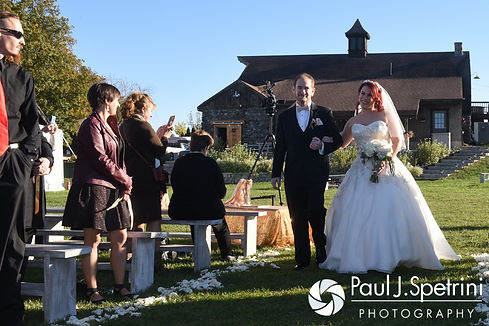 Brooke walks down the aisle during her October 2016 wedding ceremony at The Farm at SummitWynds in Jefferson, Massachusetts.