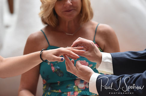 Amanda and Josh exchange rings during their October 2018 wedding ceremony at the Walt Disney World Swan & Dolphin Resort in Lake Buena Vista, Florida.