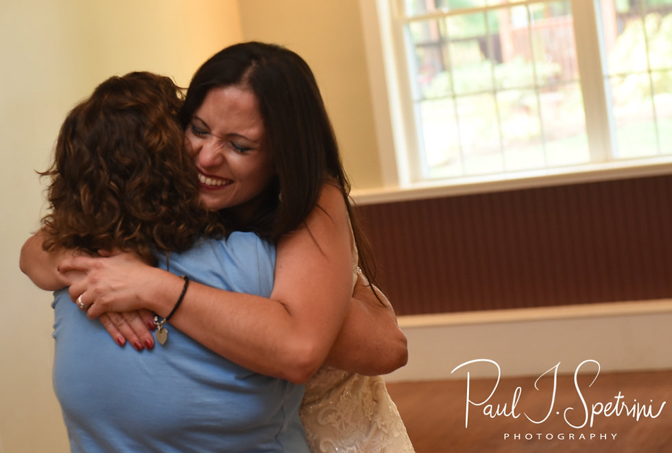 Amanda and her mother hug during her October 2018 wedding reception at Loon Pond Lodge in Lakeville, Massachusetts.