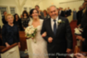 Emma and her father walk down the aisle during her November 2015 wedding at the Publick House in Sturbridge, Massachusetts.