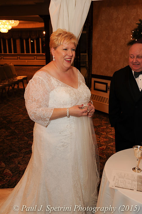 Cathy smiles during her and Ron's December 2015 wedding at Quidnessett Country Club in North Kingstown, Rhode Island.