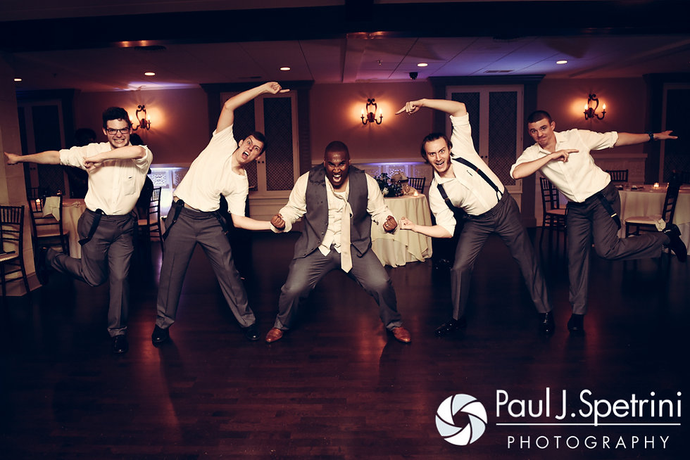 Warren and his groomsmen pose for a photo during his August 2016 wedding reception at the Villa at Riddler Country Club in East Bridgewater, Massachusetts.