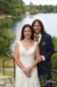 Amanda & Josh pose for a formal photo during their October 2018 wedding reception at Loon Pond Lodge in Lakeville, Massachusetts.
