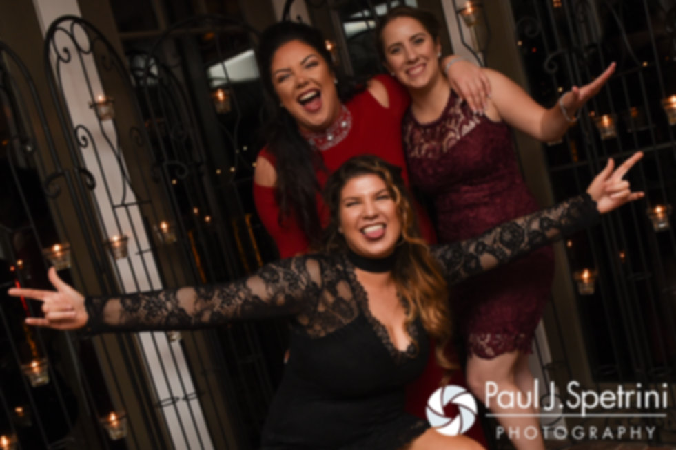 Guests pose for a photo during Gina and David's December 2016 wedding reception at the Waterman Grille in Providence, Rhode Island.