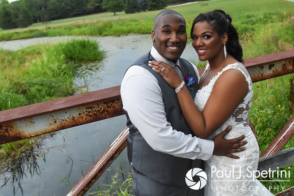 Kemi and Warren smile for a formal photo following their August 2016 wedding reception at the Villa at Riddler Country Club in East Bridgewater, Massachusetts.