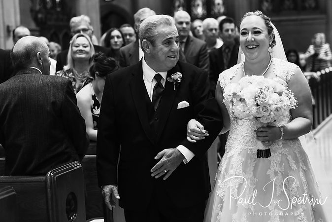 Courtney walks down the aisle with her father during her September 2018 wedding ceremony at St. Paul Church in Cranston, Rhode Island.