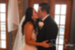 Nicole and Dan kiss during their September2018 wedding ceremony at The Towers in Narragansett, Rhode Island.