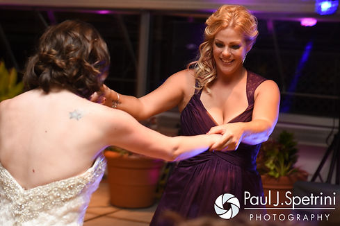 Guests dance during Jen and Kyle's September 2016 wedding reception at the Roger Williams Park Botanical Center in Providence, Rhode Island.