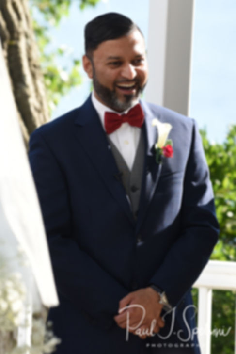 Jimmy smiles as he sees Saken come down the aisle during his July 2018 wedding ceremony at Lake Pearl in Wrentham, Massachusetts.