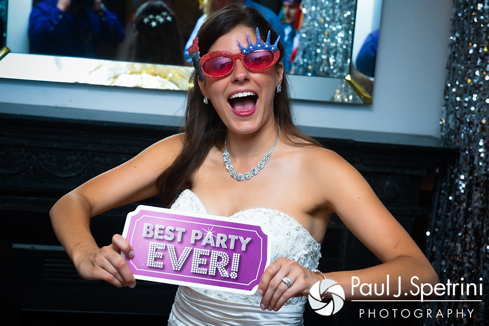 Marissa smiles for a photo during her September 2016 wedding reception at the Aqua Blue Hotel in Narragansett, Rhode Island.