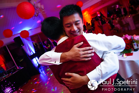 Ao hugs his best man during his August 2017 wedding reception at Lake Pearl in Wrentham, Massachusetts.