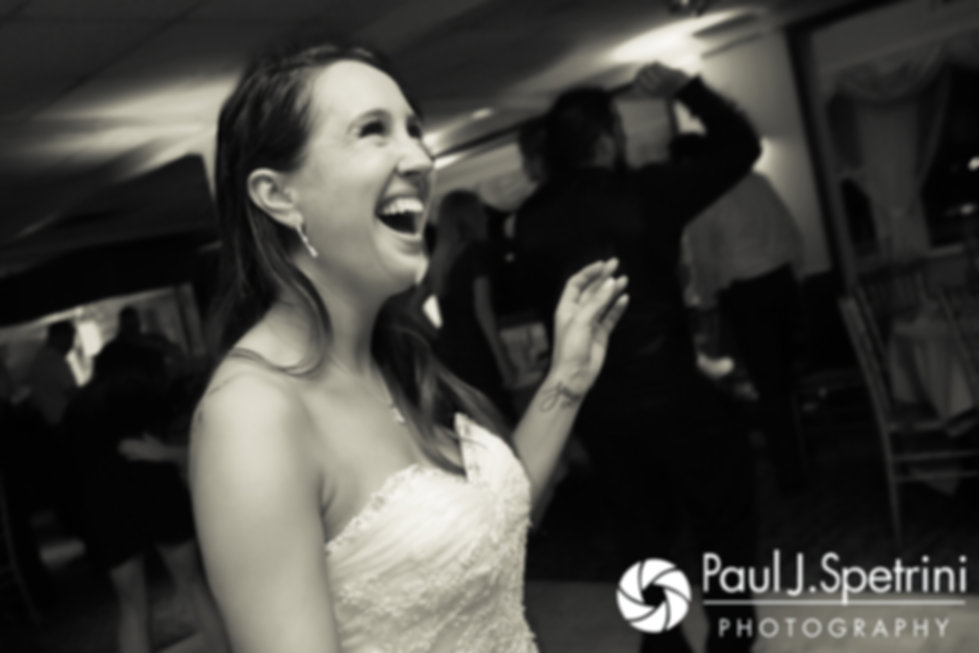 Stacey laughs during her September 2017 wedding reception in Warren, Rhode Island.
