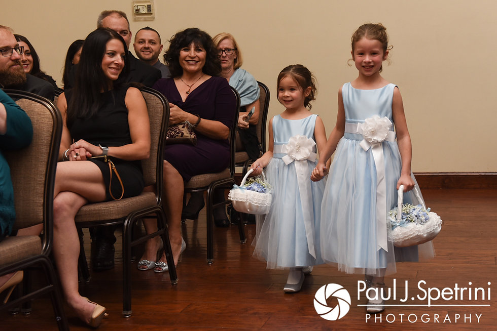 Two flower girls walk down the aisle during Kevin and Joanna's October 2017 wedding ceremony at Cranston Country Club in Cranston, Rhode Island.
