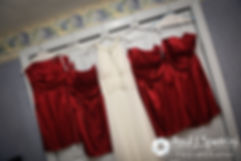 Latasha's wedding dress and the dresses of her bridesmaids hang from a closet door prior to her May 2016 wedding at Country Gardens in Rehoboth, Massachusetts.