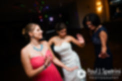 Marissa dances with her mother and a bridesmaid during her September 2016 wedding reception at the Aqua Blue Hotel in Narragansett, Rhode Island.