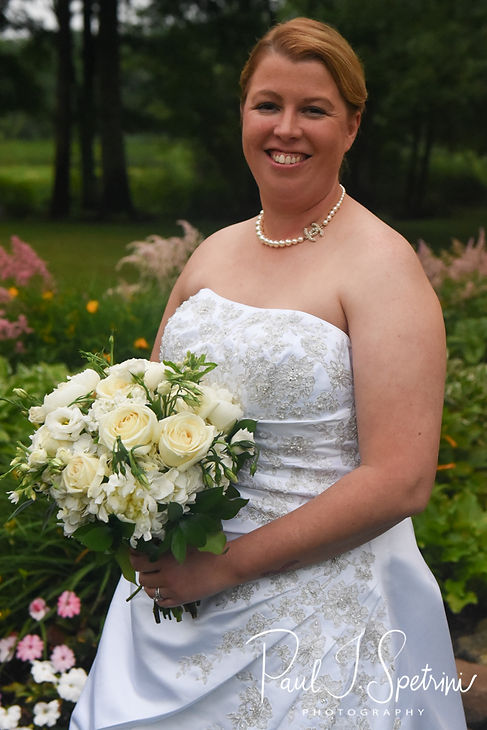 Marijke poses for a bridal portrait following her June 2018 wedding ceremony at Independence Harbor in Assonet, Massachusetts.