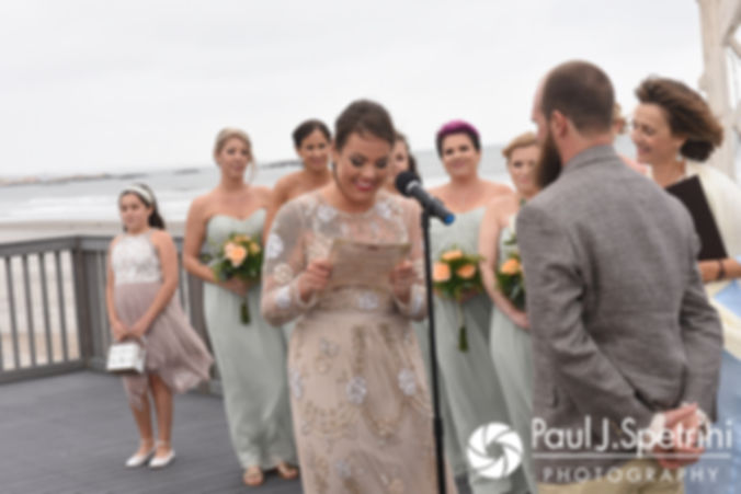 Arielle reads her vows during her September 2017 wedding ceremony at North Beach Club House in Narragansett, Rhode Island.