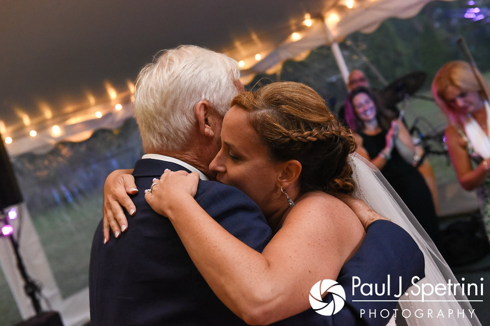 Rebecca hugs her father during her August 2017 wedding reception in Warwick, Rhode Island.