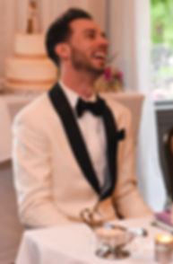 Joe laughs during a toast during their May 2018 wedding reception at Crystal Lake Golf Club in Mapleville, Rhode Island.