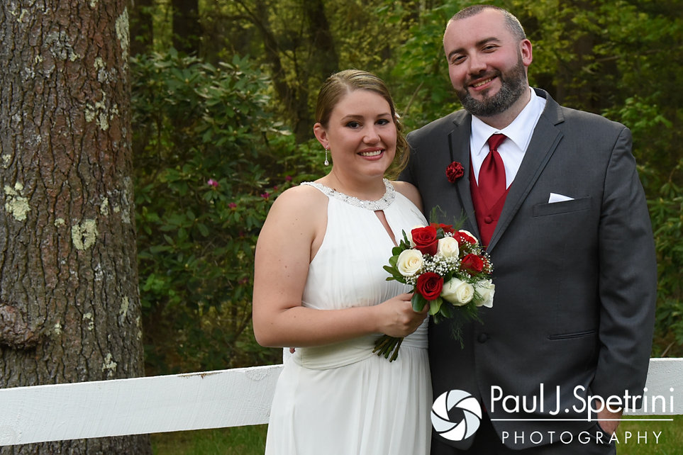 Latasha and Justin smile for formal photos prior to their May 2016 wedding at Country Gardens in Rehoboth, Massachusetts.