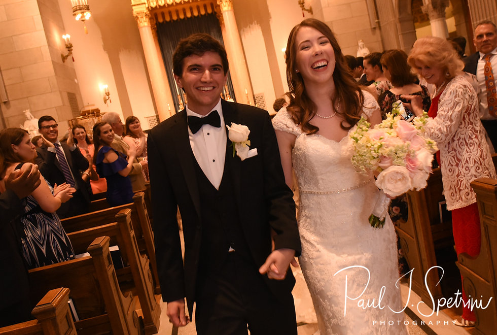 Brian and Sarah walk down the aisle following their June 2018 wedding ceremony at the College of the Holy Cross in Worcester, Massachusetts.