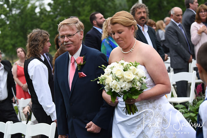 Marijke walks down the aisle during her June 2018 wedding ceremony at Independence Harbor in Assonet, Massachusetts.