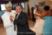 Joe Andrade dances during his wedding.