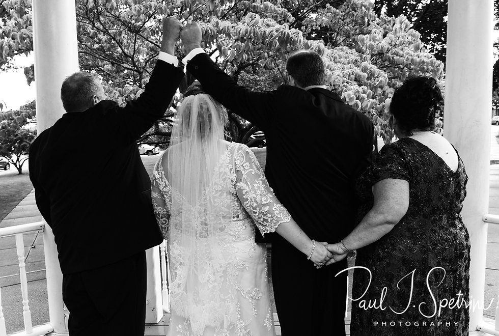 Patti and Bob pose for a photo with their best man and maid of honor following their August 2018 wedding ceremony at the Walter J. Dempsey Memorial Bandstand in Norwood, Massachusetts.