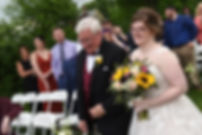Kelly and her father walk down the aisle during her June 2018 wedding ceremony at Blissful Meadows Golf Club in Uxbridge, Massachusetts.