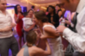Amanda dances with guests during her November 2018 wedding reception at Five Bridge Inn in Rehoboth, Massachusetts.