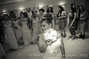 Jean Andrade gets ready to throw the bouquet.