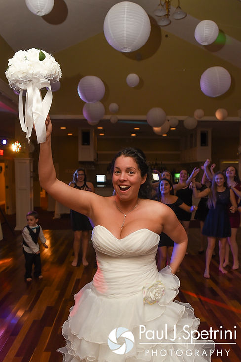 Kelly gets ready to toss a bouquet during her November 2016 wedding reception at the Bay Pointe Club in Buzzards Bay, Massachusetts.