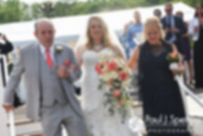 Michelle tears up as she walks down the aisle with her mother and father May 2016 wedding at Hillside Country Club in Rehoboth, Massachusetts.