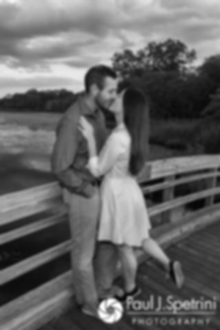 Jessica and Keiran kiss during a photo on a bridge at Ryan Park in North Kingstown, Rhode Island during their August 2017 engagement session.