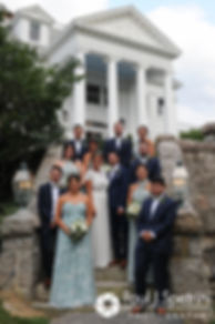 Jennifer and Bruce pose for a formal photo with their wedding party prior to their August 2017 wedding reception at The Inn at Mystic in Mystic, Connecticut.