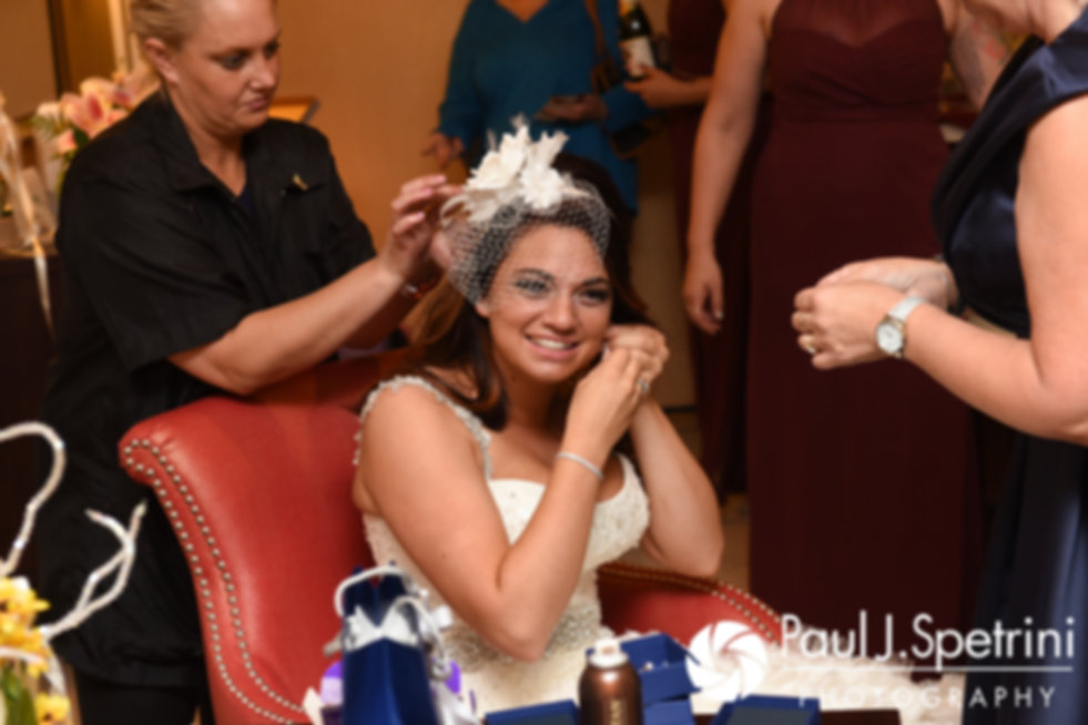 Nicky adjusts her earrings prior to her September 2017 wedding ceremony at the Crowne Plaza Hotel in Warwick, Rhode Island.