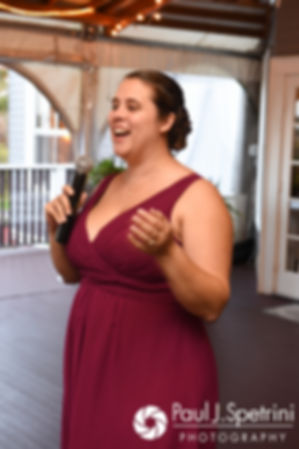 The maid of honor gives a toast during Mike and Rachel's October 2017 wedding reception at Castle Manor Inn in Gloucester, Massachusetts.