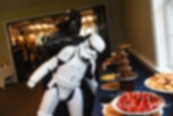 Darth Vader tries to dunk a stormtrooper in a chocolate fountain during Amanda & Josh''s October 2018 wedding reception at Loon Pond Lodge in Lakeville, Massachusetts.