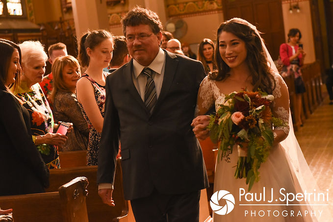 Jessica walks down the aisle during her October 2017 wedding ceremony at the Assumption of the Blessed Virgin Mary Church in Providence, Rhode Island.